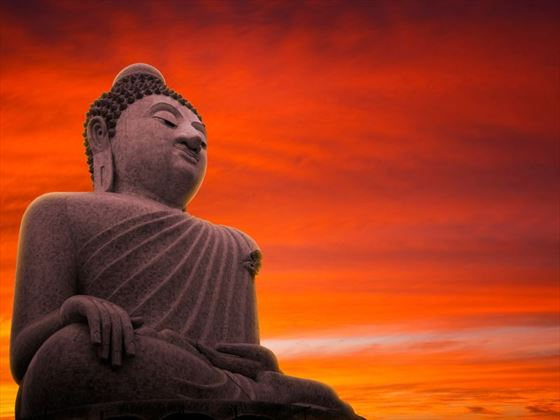 Large Buddha statue at sunset