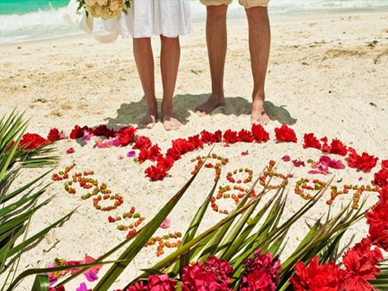 Bride & Groom on the beach at Bali Mandira Beach Resort & Spa