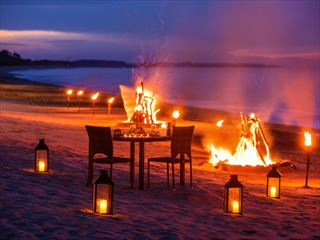 Three Course Dinner on the beach with a bottle of wine and a bonfire