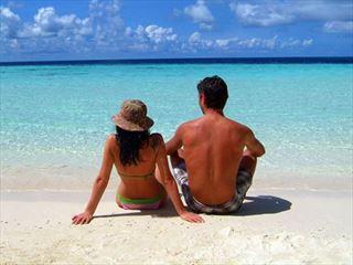 Couple on beach at Biyadhoo Hotel
