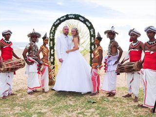 Bride & Groom flanked by traditional dancers & drummers