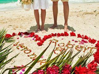 Bride & Groom on the beach at Bali Mandira Beach Resort & Spa