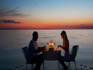 Enjoy romantic beachfront dining with spectacular views of the Maldives on your boutique vacation