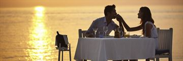 Couple dining on adult-only beach