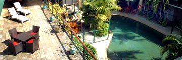 Balcony and Pool at Bay Village Tropical Retreat
