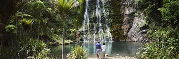 Exploring Karekare Waterfall in Auckland together