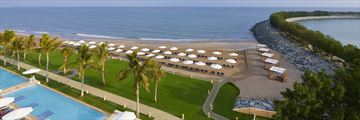 The private beach at Millennium Resort Mussanah