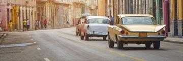 Vintage cars driving along Havana streets