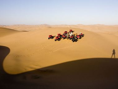 Go quad biking in the Namibian dunes