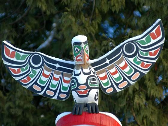 Close up of a snow covered totem pole in Stanley Park, Vancouver
