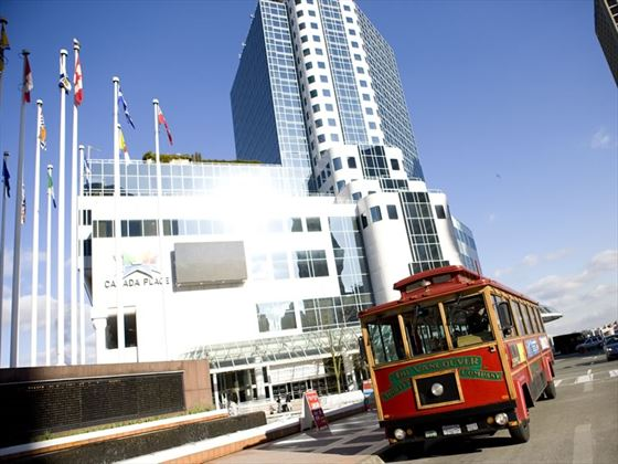 Vancouver trolley bus in front of Canada Place, downtown Vancouver