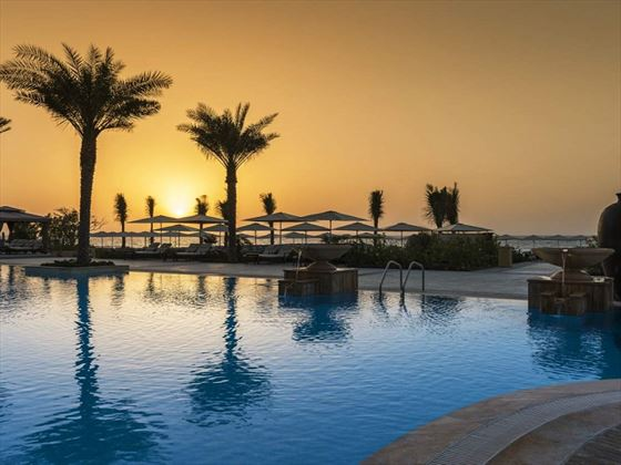 Ajman Saray pool at sunset