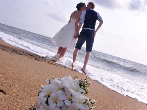 Bride and groom on the beach at AVANI Kalutara