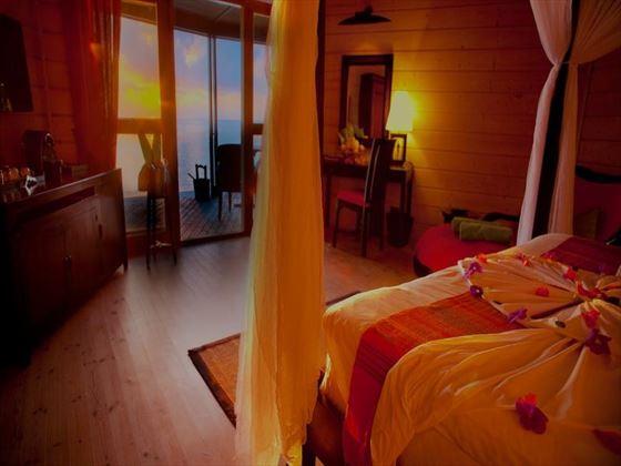 Beach Villa bedroom at Komandoo Island Resort