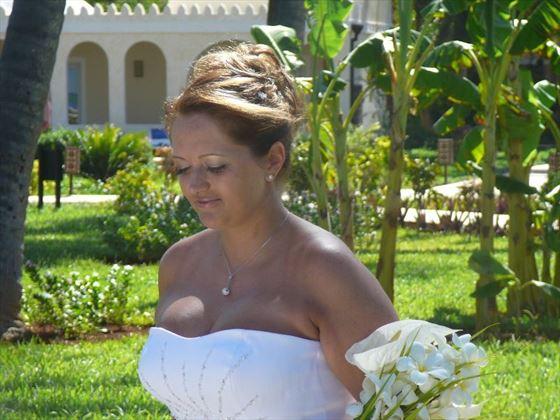 The blushing bride walking down the aisle
