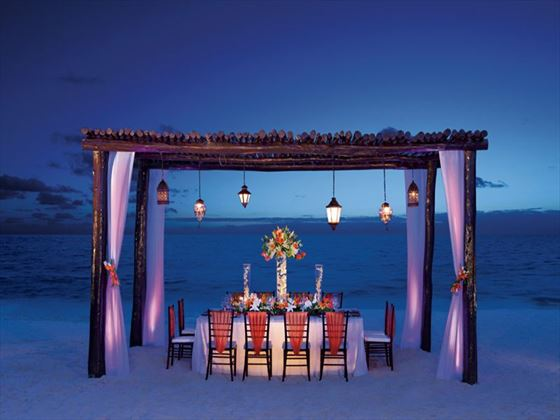 Private dinner set up on the beach for a small group.