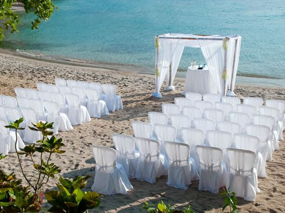 This sun-kissed, white sand beach is an intimate, casual, natural setting for a barefoot wedding ceremony