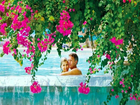 Couple relaxing in the pool