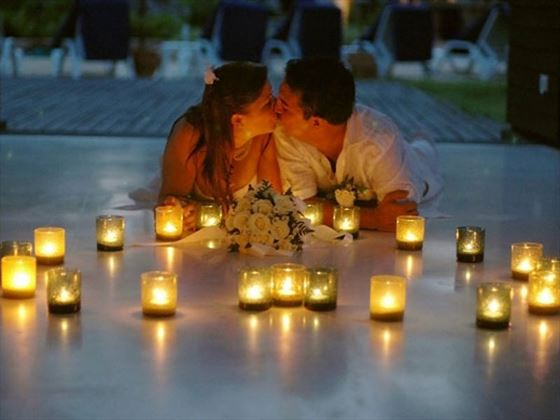 Couple surrounded by candles