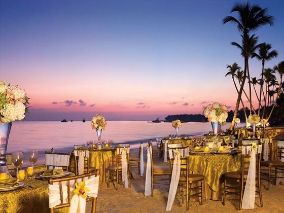 A dinner set-up on the sandy-white beach at Dreams Palm Beach