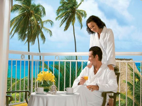 Couple enjoys the luxury of 24-hour room service on their private balcony