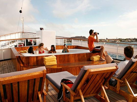 Watch the Galapagos glide by from the sun deck