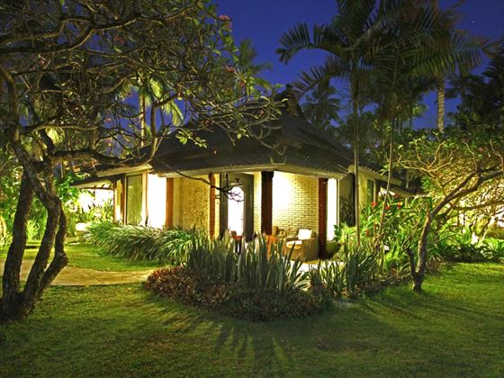 Exterior view of Candi Beach Cottage at night
