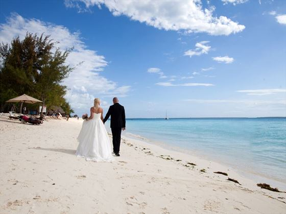 Wedding couple on the beach at Hideaway of Nungwi Resort
