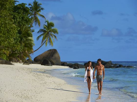 Romantic beach walk at the Hilton Seychelles Labriz Resort & Spa