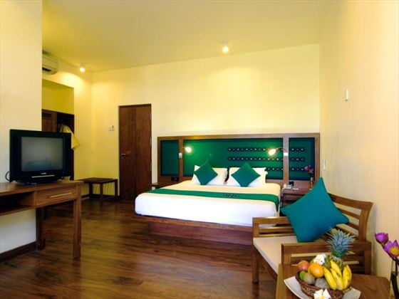 Interior view of bedroom at Mermaid Hotel & Club