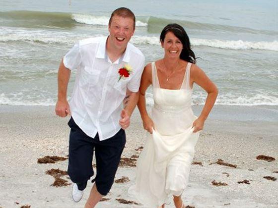 Bride & Groom running on the beach