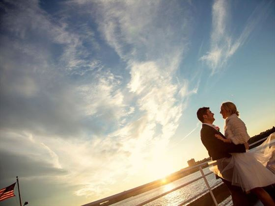 Bride & Groom on board at sunset