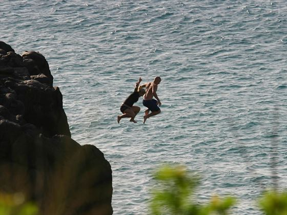 Jumping into the sea, Oahu, Hawaii