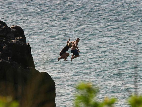 Jumping into the sea, Oahu, Hawaii