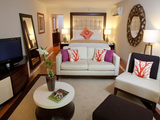 Living room in Ocean View Junior Suite at The House by Elegant Hotels