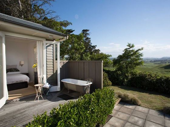 Outdoor bathtub at The Cottage at Greenhill Lodge
