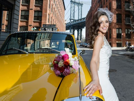 Bride with her NYC Checker taxicab