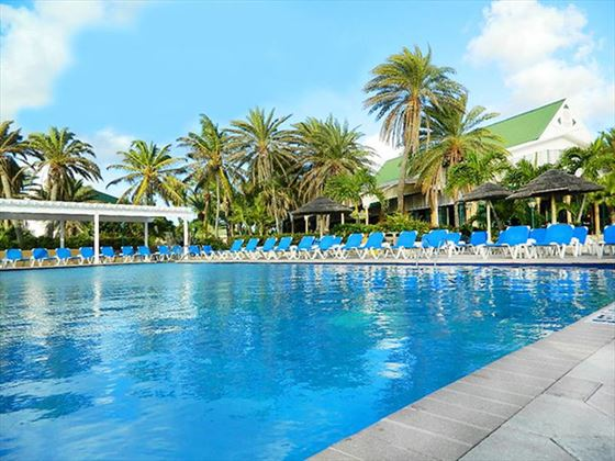 Pool area with loungers at St James's Club