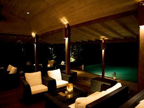 Poolside lounge area at Hermitage Bay Hotel