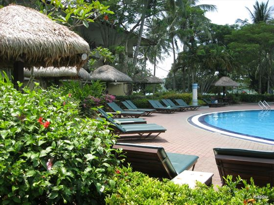 Poolside sun loungers at Holiday Villa Beach Resort & Spa Langkawi