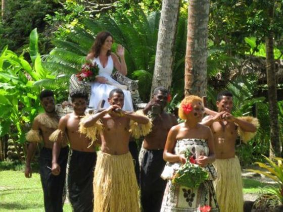 Bride escorted by Fijian warriors at Qamea Resort & Spa