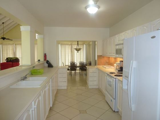 The well-equipped kitchen leading through to the dining area
