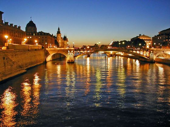 Enjoy an evening cruise on the River Seine