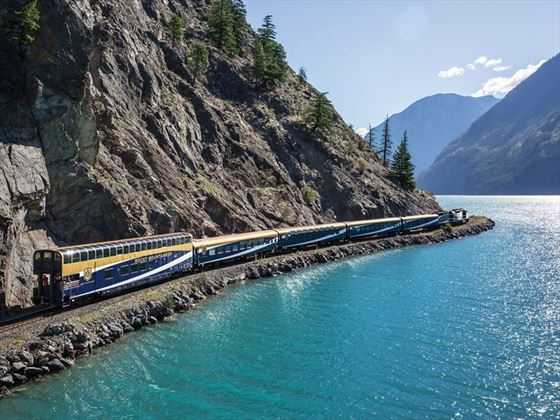 Rocky Mountaineer travelling along the sparkling waters of Seton Lake