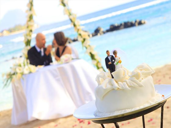 Wedding cake with Bride & Groom on the beach