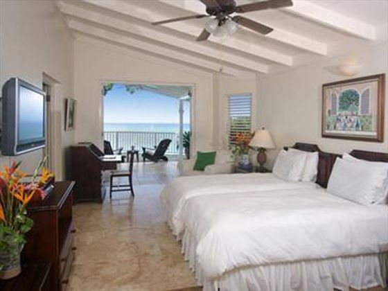 One of the bedrooms with views of the Caribbean