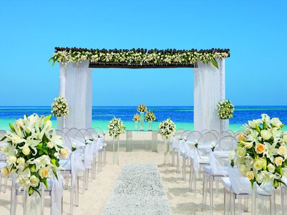 he Caribbean Sea is the breathtaking backdrop of a wedding ceremony on the beach.