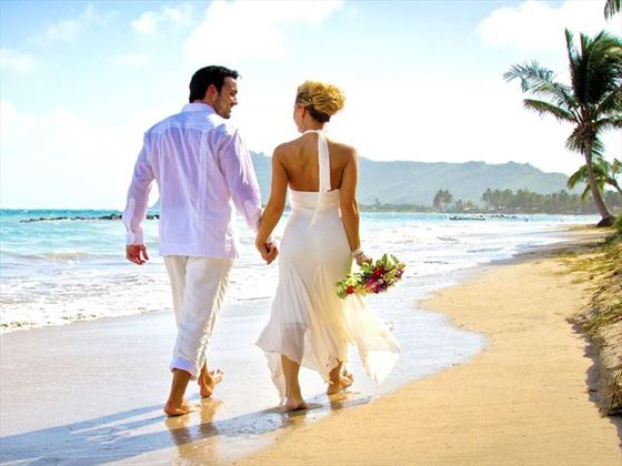 Lovers beach stroll at Coconut Bay