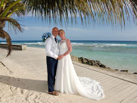Couple on the beach & boardwalk, The SoCo