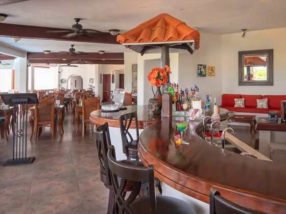The bar and restaurant at Sugar Cane Club Resort & Spa